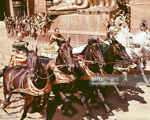 Messala played by Stephen Boyd competes against Judah BenHur played by Charlton Heston in the chariot racing scene from 'BenHur' directed by William...