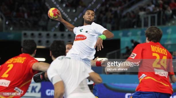 Messaoud Berkous of Algeria takes a shot during the men's Handball World Championships main round match Spain vs Algeria in Madrid Spain 11 January...