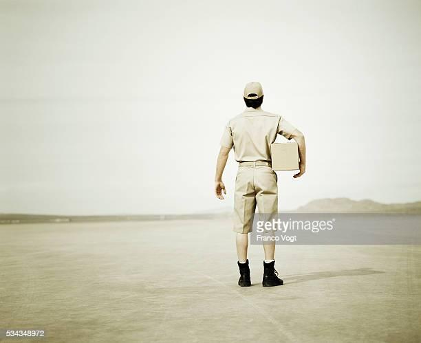 Messenger Carrying Parcel in Desert