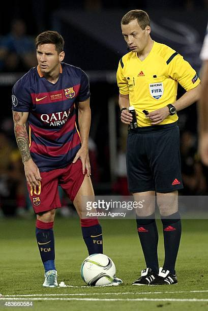Messi of Barcelona and the referee William Collum during the UEFA Super Cup match between Barcelona and Sevilla at Boris Paichadze Dinamo Arena in...