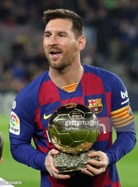 Messi offers to the fans the Golden Ball during the match between FC Barcelona and Real Club Deportivo Mallorca corresponding to the week 16 of the...