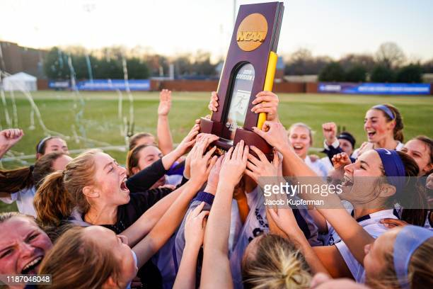 Messiah College Falcons players celebrate after the Division III Women's Soccer Championship held at UNCG Soccer Stadium on December 7, 2019 in...
