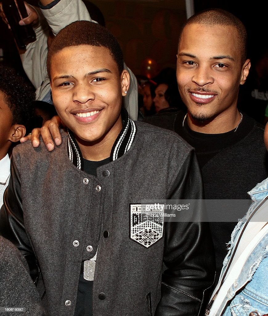 Messiah Harris and T.I. attend a birthday party for T.I.'s son Messiah at Buckhead Bottlebar on February 2, 2013 in Atlanta, Georgia.
