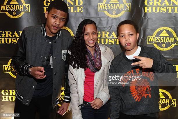 Messiah Harris Deyjah Harris and Domani Harris attend a birthday party for TI's son Messiah at Buckhead Bottlebar on February 2 2013 in Atlanta...