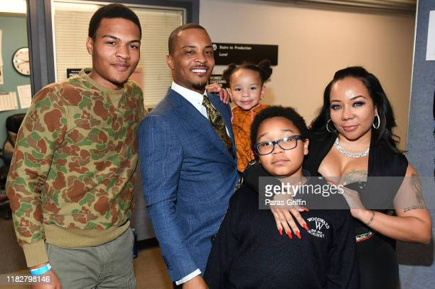 "Messiah Harris, T.I., Heiress Diana Harris, Major Harris, and Tameka ""Tiny"" Harris pose backstage during ""Between The World And Me"" Atlanta premiere..."