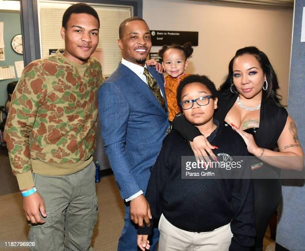 """Messiah Harris, Tip """"T.I."""" Harris, Heiress Diana Harris, Major Harris, and Tameka """"Tiny"""" Harris pose backstage during """"Between The World And Me""""..."""