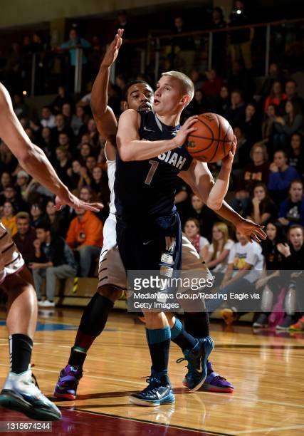 Messiah's Zac Hoy Looks to pass away from Alvernia guard Charles Cooper .MENS BASKETBALL Messiah College Falcons vs Alvernia University Crusaders at...