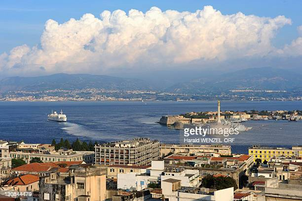 Messina and narrows, panorama view, inner harbour and ferryboat en-route, mainland at back, Sicily, Italy, Europe