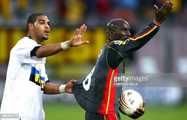 A picture taken 27 November 2005 shows Inter Milan's Adriano and Marco Andre Zoro of Messina gesturing at supporters during their Serie A football...
