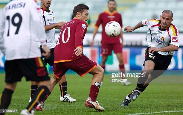 AS Roma captain Francesco Totti fights for the ball with Messina defender Marco Zanchi Marco Zanchi and Messina defender Alessandro Parisi during...