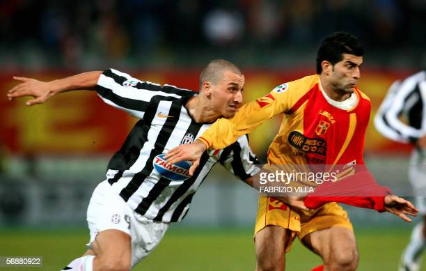 Juventus' Swedish forward Zlatan Ibrahimovic fights for the ball with Messina's defender Rezaei during their serie A football match MessinaJuventus...