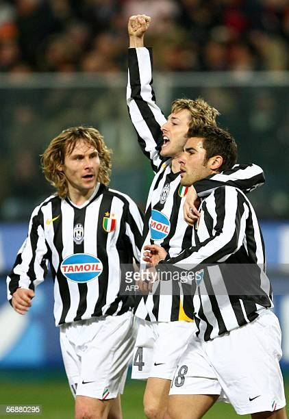 Juventus's Adrian Mutu celebrates with teammates Balzaretti and Nedved after scoring 12 against Messina during their Serie A football match...