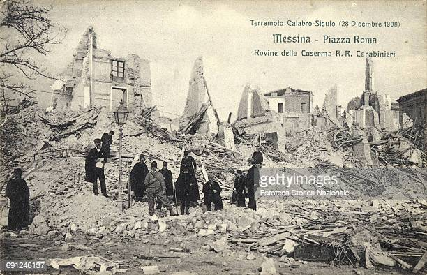 ruins of RR Carabinieri Barracks A group in uniform posing among the desolation of rubble next to a streetlight one element remained amazingly intact...