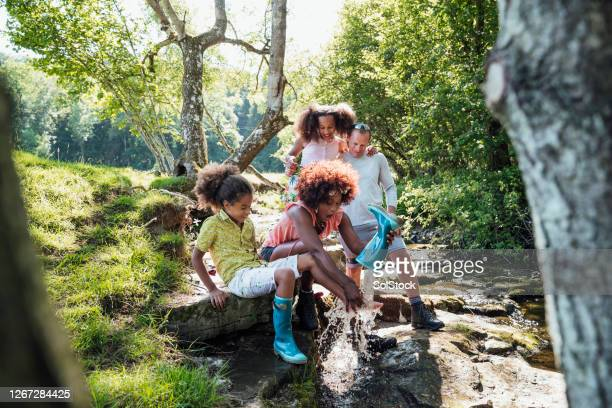 messing around at the river - black boot stock pictures, royalty-free photos & images