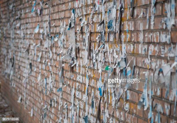 Messthetics, brick wall with torn posters