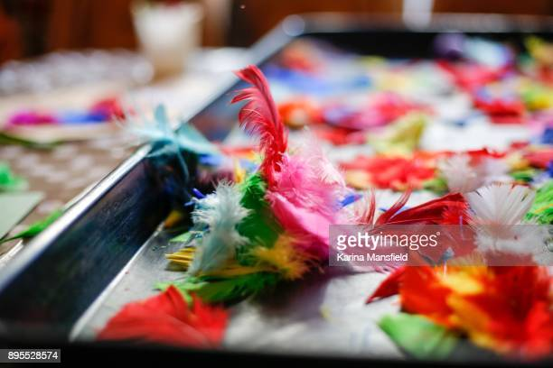 Messthetics messy play for children with coloured feathers