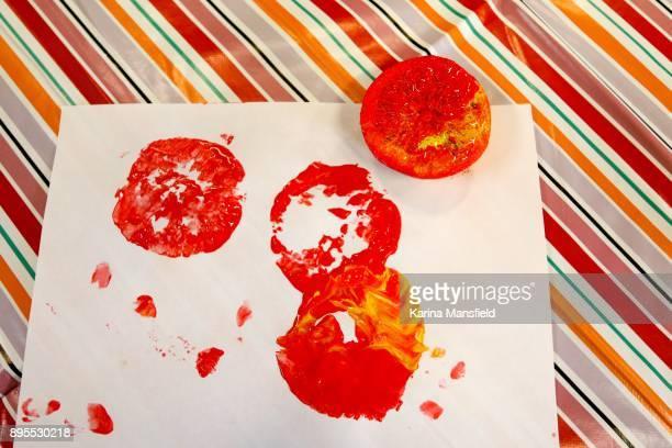 Messthetics orange printing with paints for children entertainment