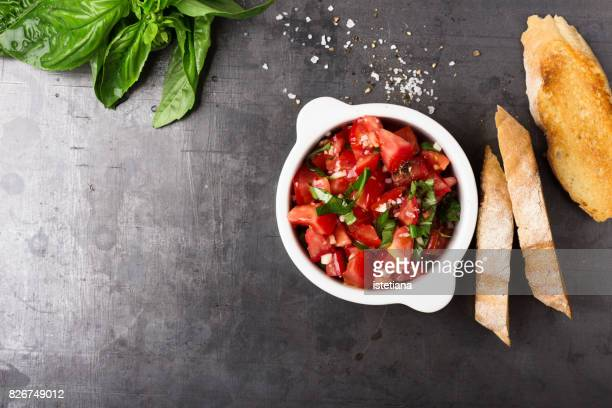 messthetics. tomato bruschetta preparation - antipasto stock pictures, royalty-free photos & images