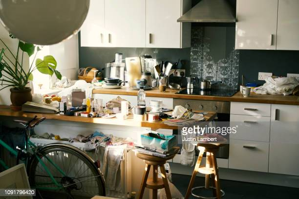 messy apartment counter tops covered in clutter - 不完全な美しさ ストックフォトと画像