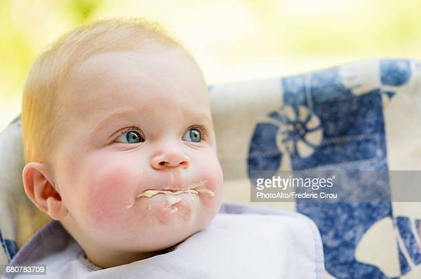 Messy baby eating, portrait
