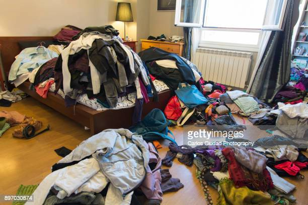 Messy bedroom with clothes and possessions thrown around