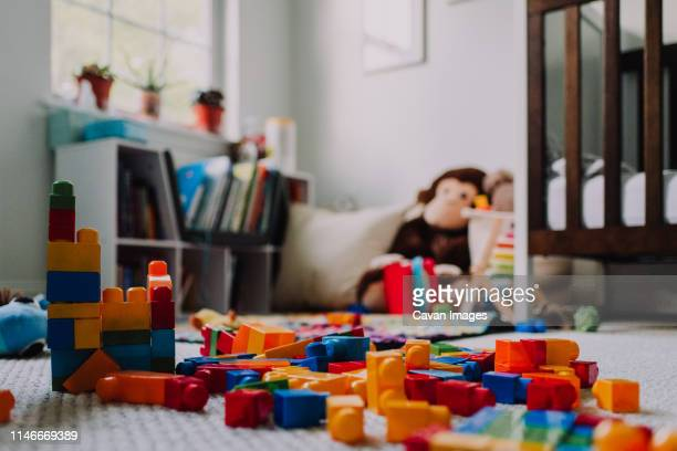 messy blocks in child's room - childhood stock pictures, royalty-free photos & images