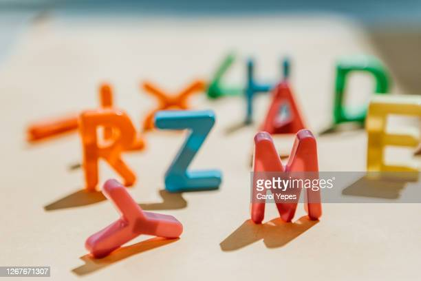 messy capital plastic letters with shadows.focus on m - learning disability stock pictures, royalty-free photos & images