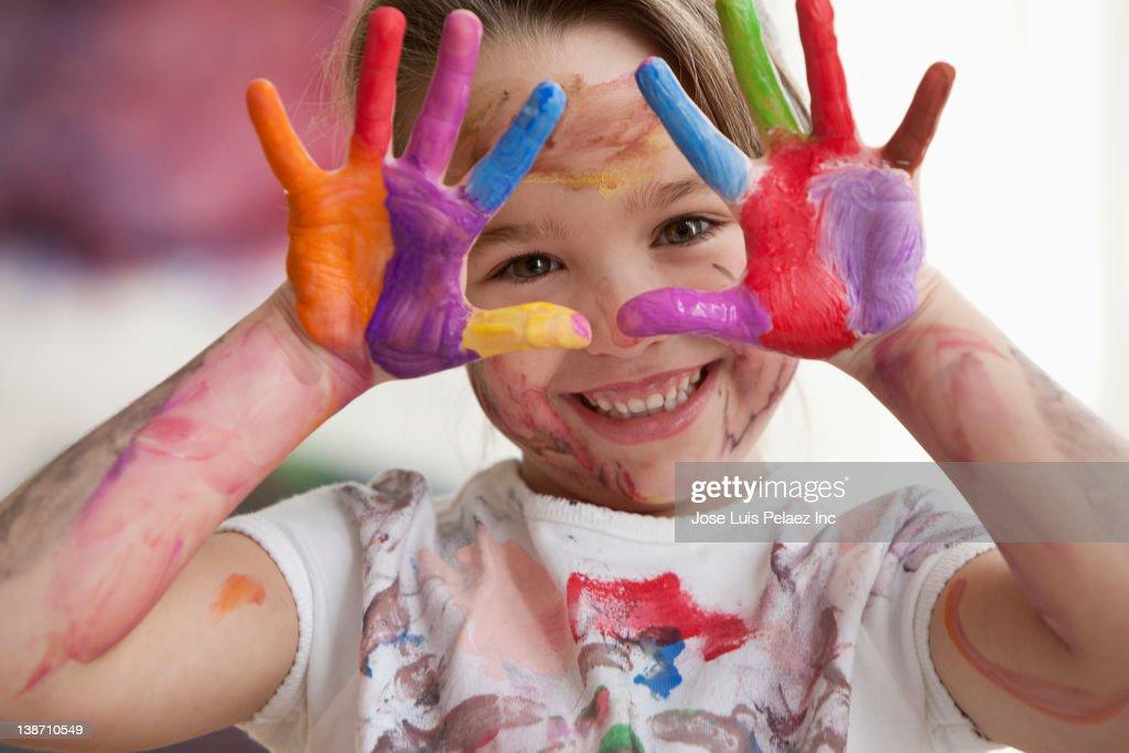 Messy Caucasian girl in art class : Stock Photo