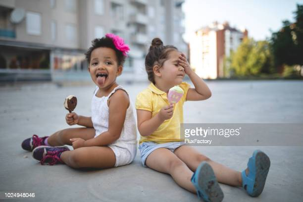 messy children enjoying melting ice cream in summer - frozen stock pictures, royalty-free photos & images