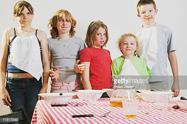 Messy children looking guilty