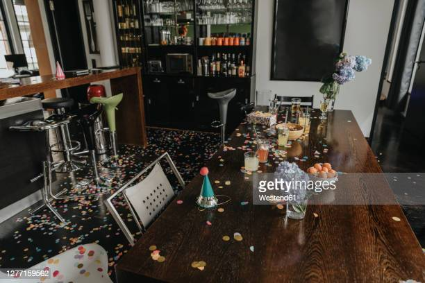 messy dining table at home after party - messy table after party stock pictures, royalty-free photos & images