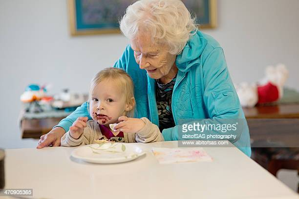 Messy faced toddler and great grandmother