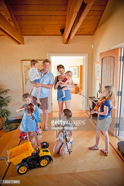 messy family portrait with violins