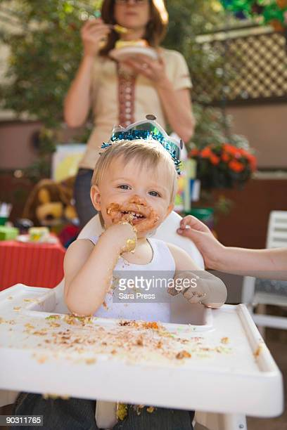 Messy girl eating at birthday party