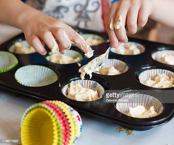 Messy hands baking fairy cakes