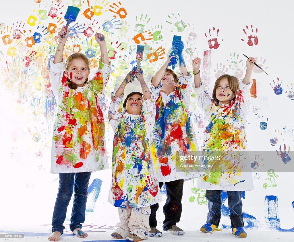 Messy Hispanic children covered in paint : ストックフォト