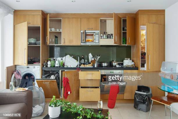 messy kitchen in apartment - messy stock pictures, royalty-free photos & images