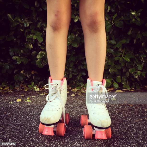 messy legs in roller skates - roller skating stock photos and pictures