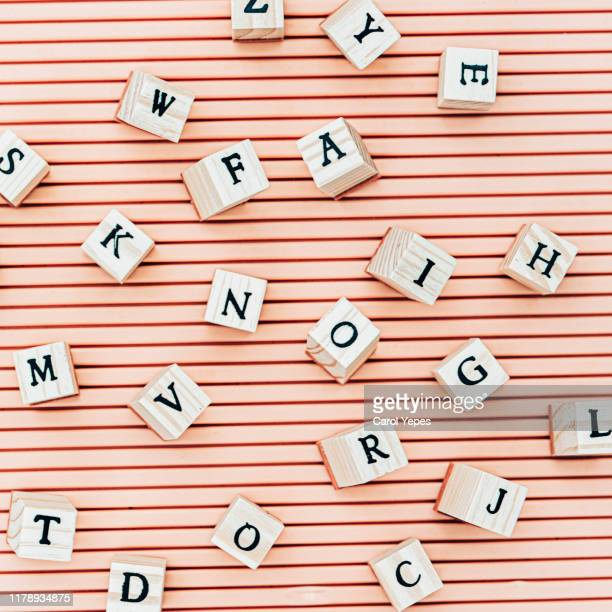 messy letters background - spelling stock pictures, royalty-free photos & images