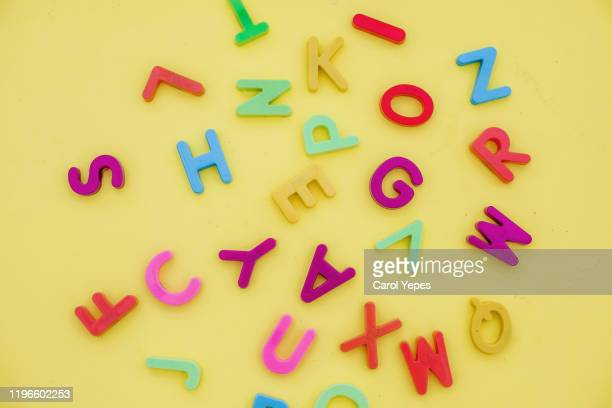 messy letters background - abc stock pictures, royalty-free photos & images
