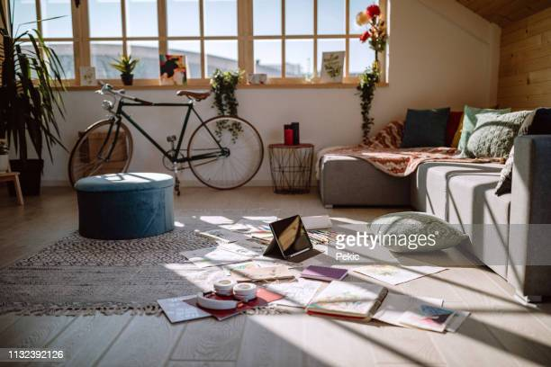 messy living room of artist - messy stock pictures, royalty-free photos & images