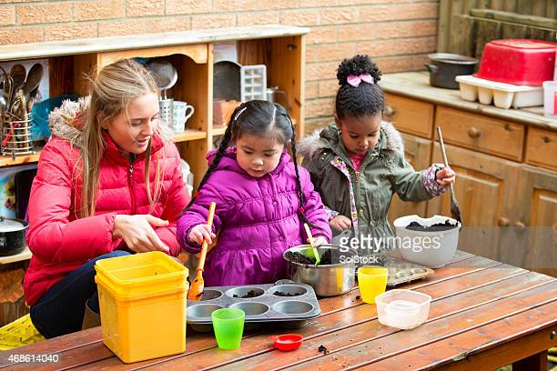 messy mud pies - britain playgrounds stock pictures, royalty-free photos & images