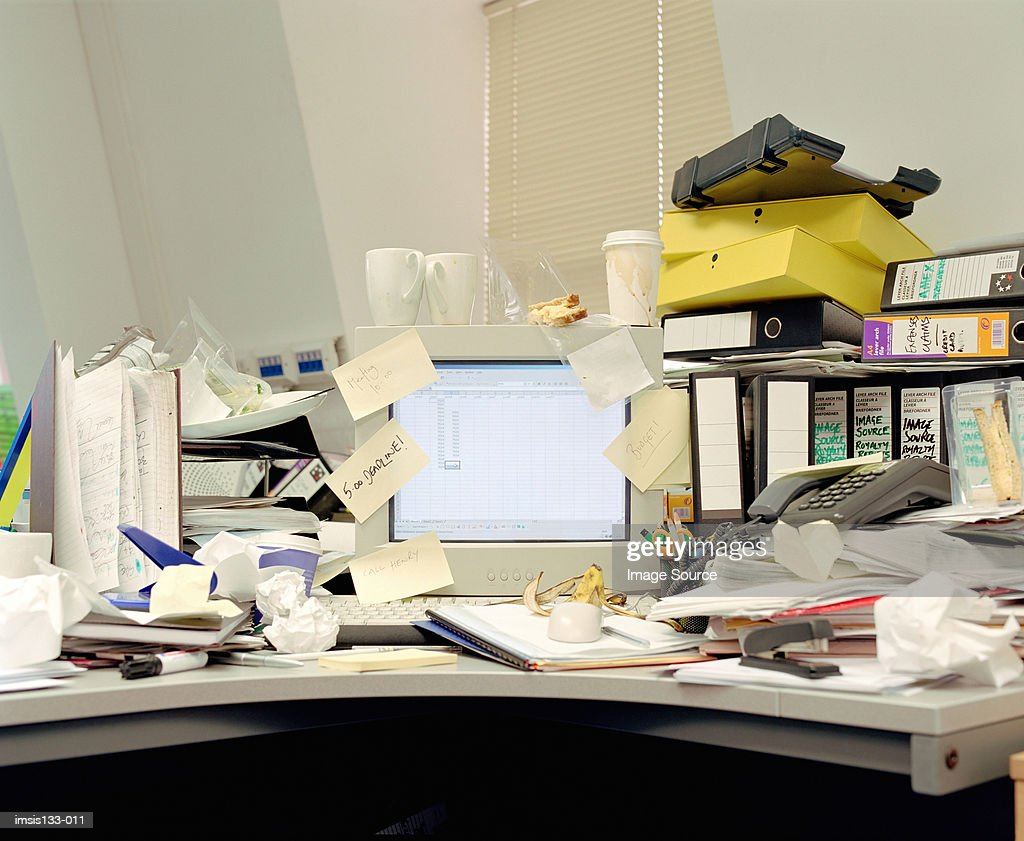 Messy office desk : Stock Photo