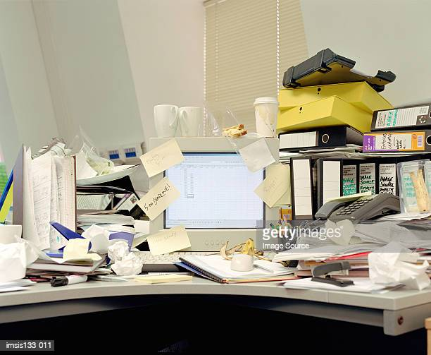 messy office desk - messy stock pictures, royalty-free photos & images