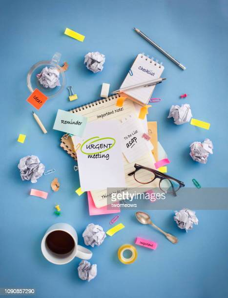 messy office table top objects image. - burden stock pictures, royalty-free photos & images