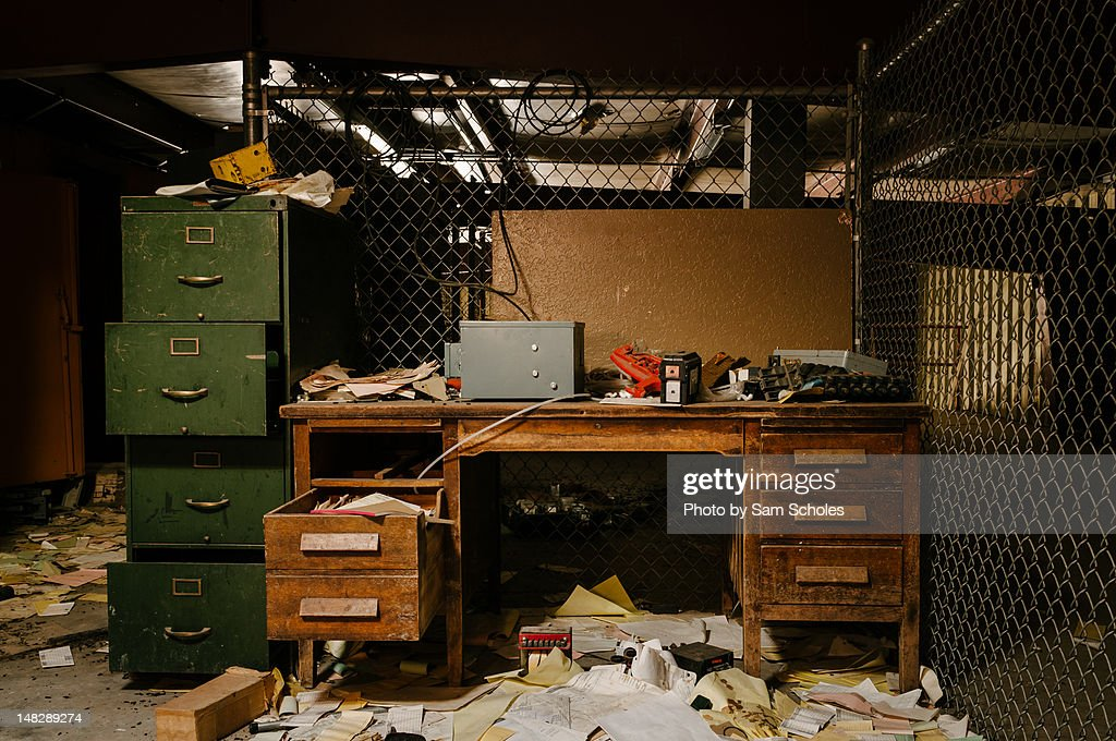 messy file cabinet. Messy Office With Desk And File Cabinet : Stock Photo