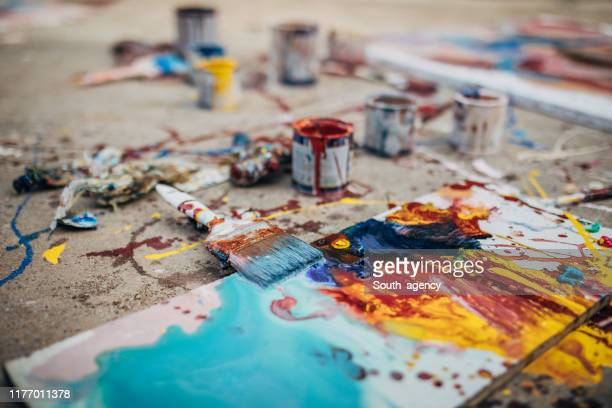 messy painting equipment on asphalt - art and craft stock pictures, royalty-free photos & images