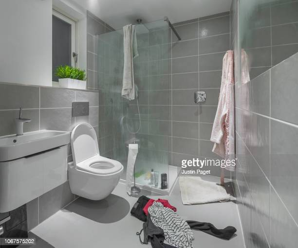 messy shower room - domestic bathroom stock pictures, royalty-free photos & images