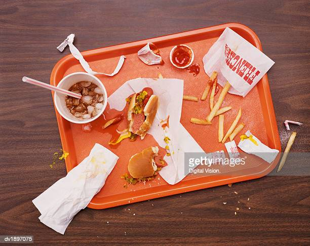 Messy Tray With Eaten Hot Dog, Fries and Cola