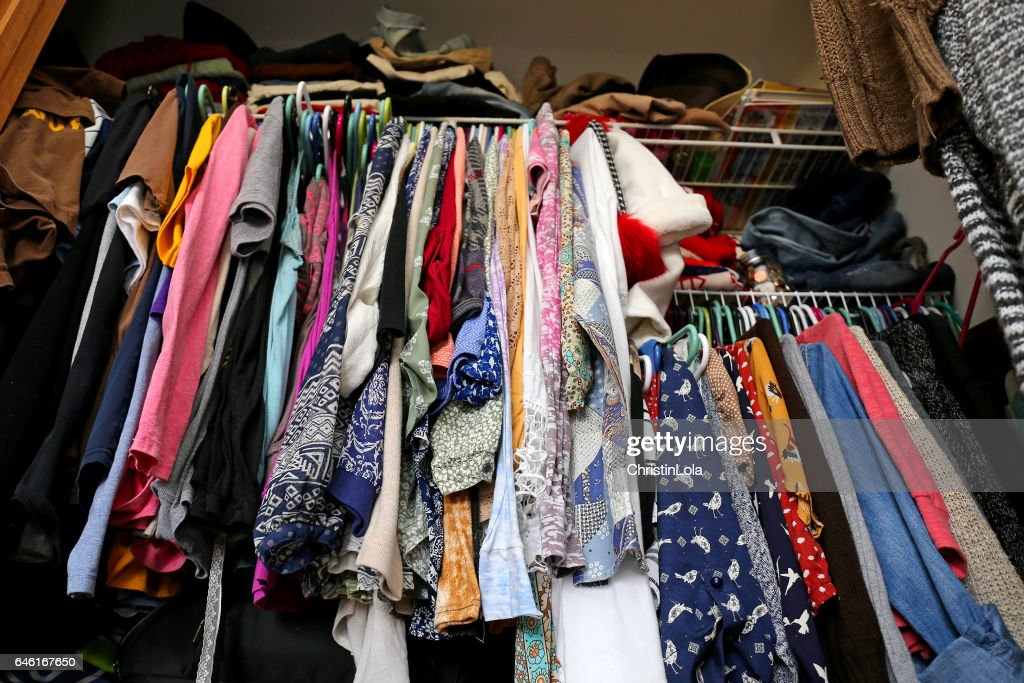 Messy Women's Closet Filled with Colorful Clothes : Stock Photo